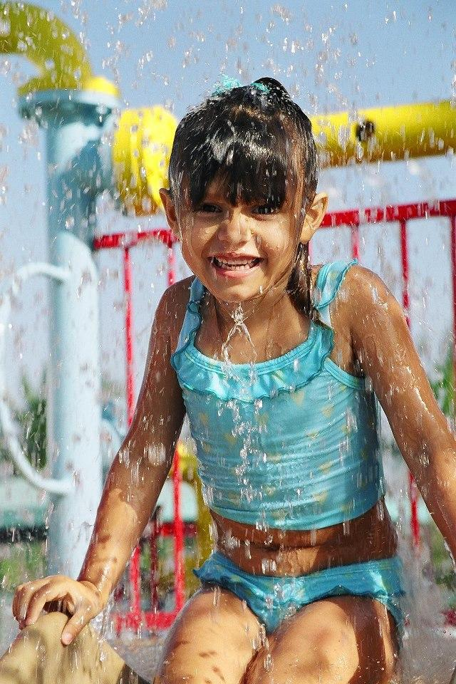 Little girl drenched in water